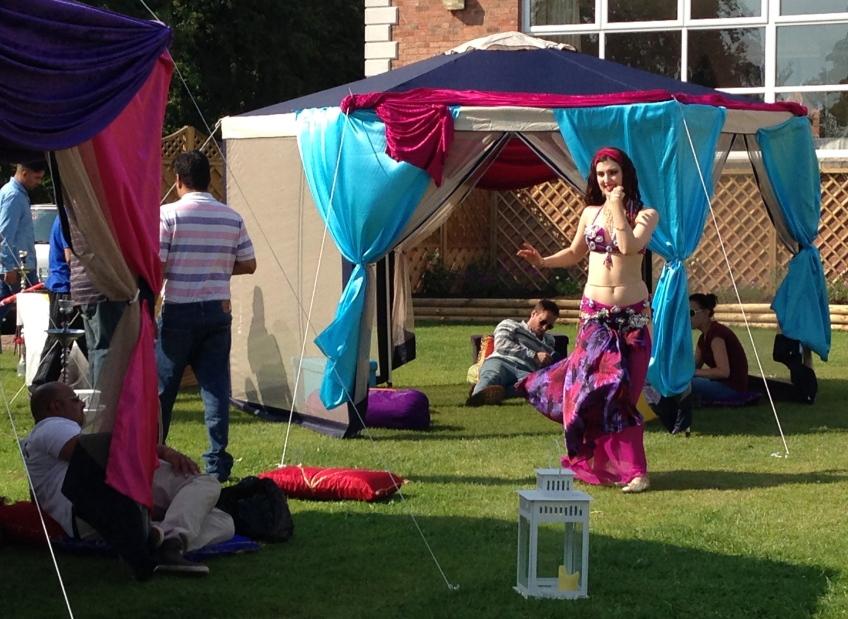 Bellydancer Rasha Nour performing at a garden party near Birmingham