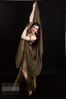 Oxford Bellydancer Rachael dancing with a veil in an olive green costume