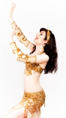 Rachael in a gold bellydance costume