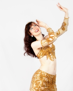 Oxford bellydancer Rasha Nour in a gold costume