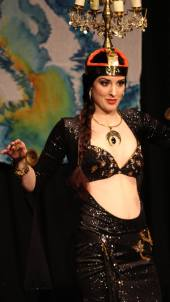 Rachael performing a candelabra dance, 'raqs shamadan', in Oxford, December 2015. Photo by Katie Musgrave.