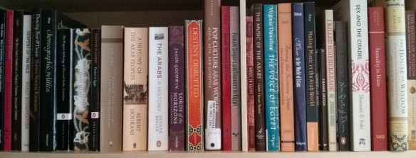 A shelf of books about Middle Eastern history, culture and music